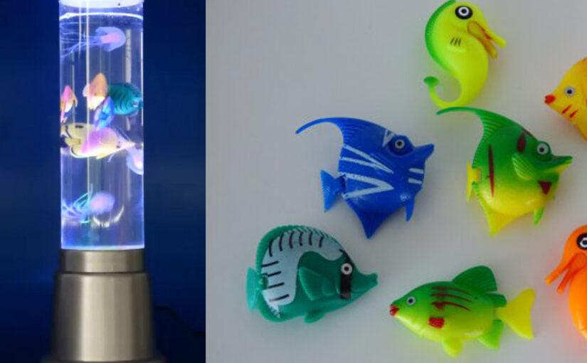 Sprudelnde Wassersäule mit schwimmenden Fischen und LED Licht